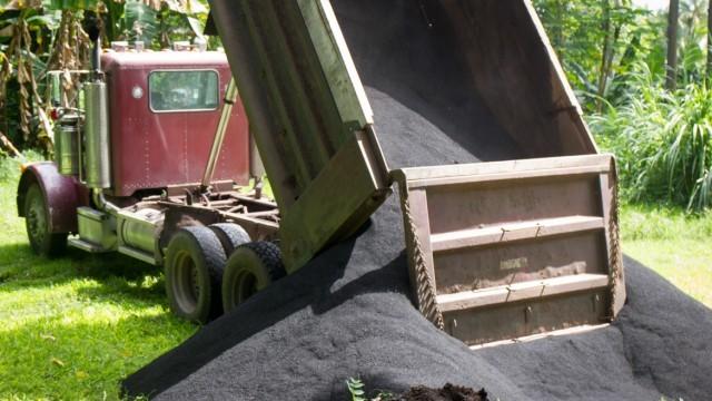 mac nut biochar by the dump truck