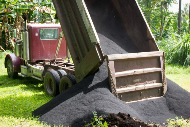 mac nut biochar by the dump truck